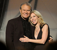Glen Campbell and Kim Campbell<br /> The 45th Annual CMA Awards, Country Music's Biggest Night, held at Bridgestone Arena, Nashville, Tennessee, USA.<br /> November 9th, 2011<br /> half length black suit dress<br /> CAP/ADM/LF<br /> &copy;Laura Farr/AdMedia/Capital Pictures