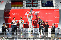 Lewis Hamilton of Mercedes AMG Petronas F1 (44) raises the trophy after winning 2014 Formula 1 United States Grand Prix race, Sunday, November 02, 2014 in Austin, Tex. (Mo Khursheed/TFV Media via AP Images)