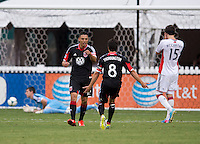 Luis Silva (12) of D.C. United celebrates his goal with teammate John Thorrington (8) during a Major League Soccer game at RFK Stadium in Washington, DC.  New England defeated D.C. United, 2-1.