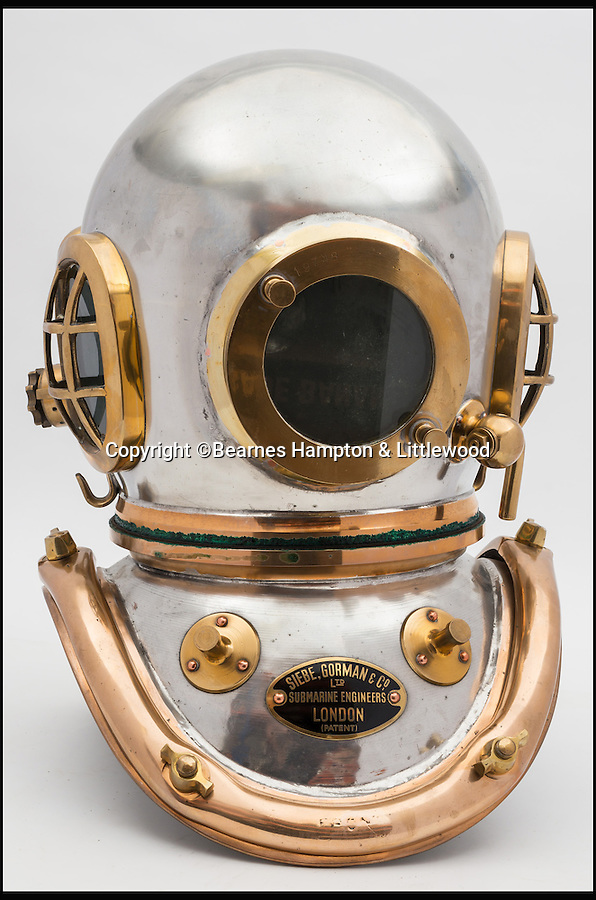 BNPS.co.uk (01202 558833)<br /> Pic: BHandI/BNPS<br /> <br /> A tinned 6-bolt admiralty pattern diving helmet.<br /> <br /> A British couple's lifetime hobby of deep sea diving is set to make them a breathtaking £500,000 when they sell one of the world's finest collection of vintage diving helmets.<br /> <br /> Anthony and Yvonne Pardoe amassed over 150 heavyweight copper helmets worn by divers during the early days of underwater excavation.<br /> <br /> Weighing about 55lbs, the dome-shaped helmets bolted onto a copper collar of a diving suit and had a hose attached to the rear to provide air supply from the surface.<br /> <br /> They are being sold in Devon next month.