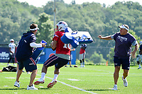 August 1, 2017: New England Patriots head coach Bill Belichick and offensive coordinator Josh McDaniels throw blocking cushions at quarterback Jimmy Garoppolo (10) during the New England Patriots training camp held at Gillette Stadium, in Foxborough, Massachusetts. Eric Canha/CSM