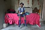 Chedline Cherichel, 16, does her school homework in her bedroom in her family's new home in Lareserve, a village near Jean-Rabel in northwestern Haiti. The family's previous house was destroyed during Hurricane Matthew in 2016, and Church World Service, a member of the ACT Alliance, helped the family build their sturdy new home.<br /> <br /> Parental consent obtained.