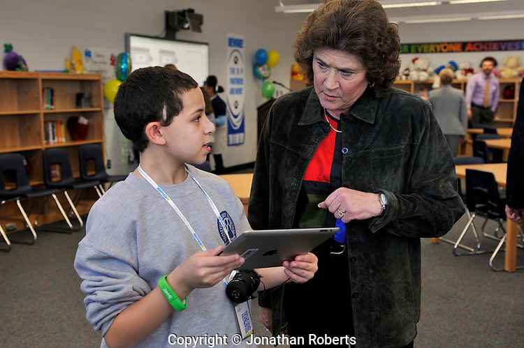 Board Member Linda Duncan watches a student work with an iPad...Roosevelt-Perry Elementary School celebrates the opening of its technology wing.