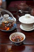 Pouring cups of young Yunnanese Puehr tea, Hong Kong.