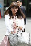 """July 2, 2010 - Tokyo, Japan - Rina Bovrisse's, former senior Retail manager at Prada Japan, arrives at Tokyo District Court for the 2nd Hearing of Prada Japan Case, on July 2, 2010. Rina Bovrisse, joined by two other """"former Prada  Japan employees, is suing the Italian fashion designer after she was placed on involuntary leave last November. The 36-year-old Japanese national had claimed she was asked to 'eliminate' around 15 managerial staff who was categorized as """"aged, ugly, fat, bad body shape, bad teeth, disgusting, and not cute."""""""