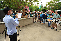 NWA Democrat-Gazette/ANDY SHUPE<br /> Stephen Coger, director of the Arkansas Justice Collective, speaks Saturday, June 17, 2017, during the Don't Deport Dad! rally in front of the Fayetteville Towncenter. Ozark Indivisible and the Arkansas Justice Collective partnered to organize the rally to pressure the Washington County Sheriff's Office to end its efforts to assist Federal agencies in the deportation of residents.