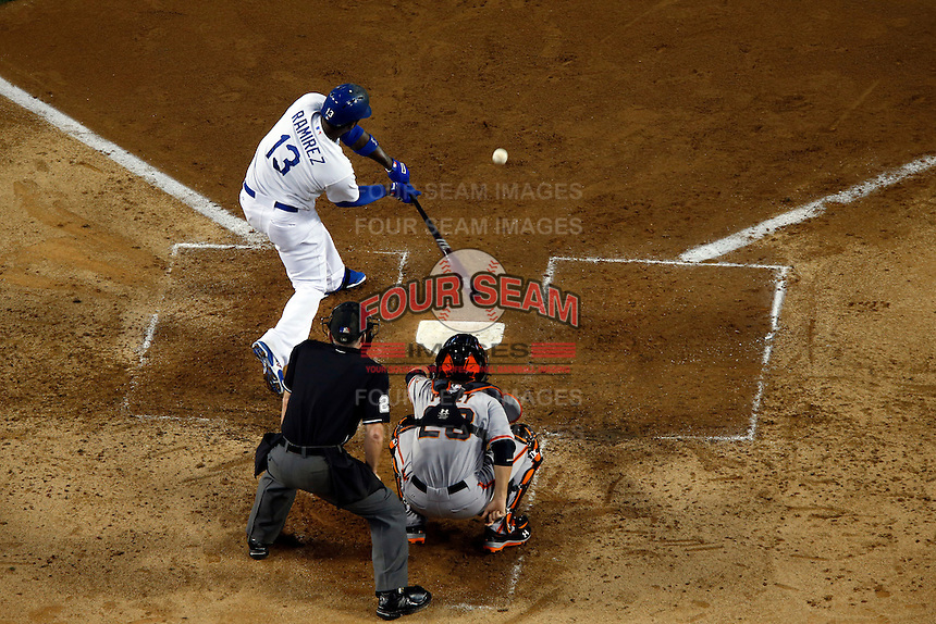 Hanley Ramirez #3 of the Los Angeles Dodgers bats against the San Francisco Giants and the Giants catcher Buster Posey #28 at Dodger Stadium on June 25, 2013 in Los Angeles, California. (Larry Goren/Four Seam Images)