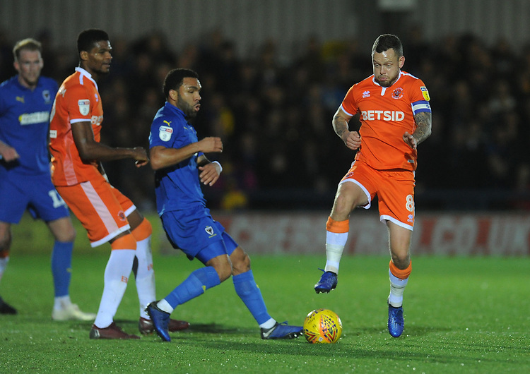 Blackpool's Jay Spearing vies for possession with AFC Wimbledon's Andy Barcham<br /> <br /> Photographer Kevin Barnes/CameraSport<br /> <br /> The EFL Sky Bet League One - AFC Wimbledon v Blackpool - Saturday 29th December 2018 - Kingsmeadow Stadium - London<br /> <br /> World Copyright © 2018 CameraSport. All rights reserved. 43 Linden Ave. Countesthorpe. Leicester. England. LE8 5PG - Tel: +44 (0) 116 277 4147 - admin@camerasport.com - www.camerasport.com