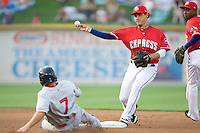 Shortstop Luis Cruz #7 of the Round Rock Express turns a double play against the Oklahoma City RedHawks on April 26, 2011 at the Dell Diamond in Round Rock, Texas. (Photo by Andrew Woolley / Four Seam Images)