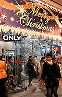 Chinese residents shop in a department store in downtown Beijing, China..10 Dec 2005