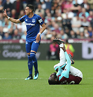 West Ham United's Arthur Masuaku in pain after being challenged by Everton's Ramiro Funes Mori<br /> <br /> Photographer Rob Newell/CameraSport<br /> <br /> The Premier League - West Ham United v Everton - Sunday 13th May 2018 - London Stadium - London<br /> <br /> World Copyright &copy; 2018 CameraSport. All rights reserved. 43 Linden Ave. Countesthorpe. Leicester. England. LE8 5PG - Tel: +44 (0) 116 277 4147 - admin@camerasport.com - www.camerasport.com