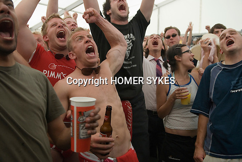 Male British Football Fans Cheering Happy Watching Soccer On Tv Uk