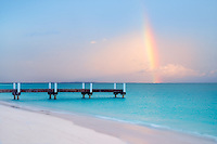 Pier rainbow and beach Turks and Caicos. Providenciales