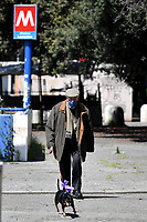 An older man, wearing a mask, takes his dog for a walk <br /> Roma 24/04/2020 <br /> City lockdown as a measure to contrast the covid-19 coronavirus pandemic <br /> Photo Andrea Staccioli Insidefoto