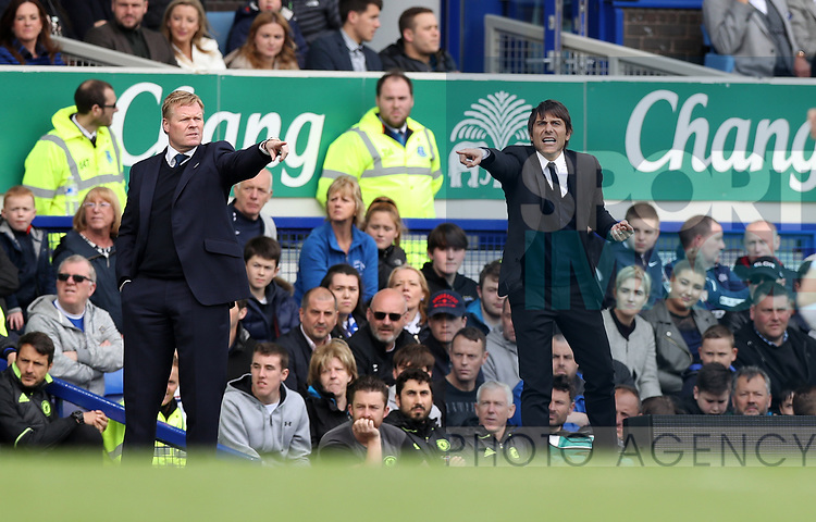 Antonio Conte manager of Chelsea and Everton manager Ronald Koeman  during the English Premier League match at Goodison Park , Liverpool. Picture date: April 27th, 2016. Photo credit should read: Lynne Cameron/Sportimage