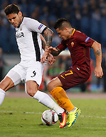Calcio, Europa League: Roma vs Astra Giurgiu. Roma, stadio Olimpico, 29 settembre 2016.<br /> Roma&rsquo;s Juan Iturbe, right, is challenged by Astra Giurgiu&rsquo;s Fabricio during the Europa League Group E soccer match between Roma and Astra Giurgiu at Rome's Olympic stadium, 29 September 2016. Roma won 4-0.<br /> UPDATE IMAGES PRESS/Riccardo De Luca