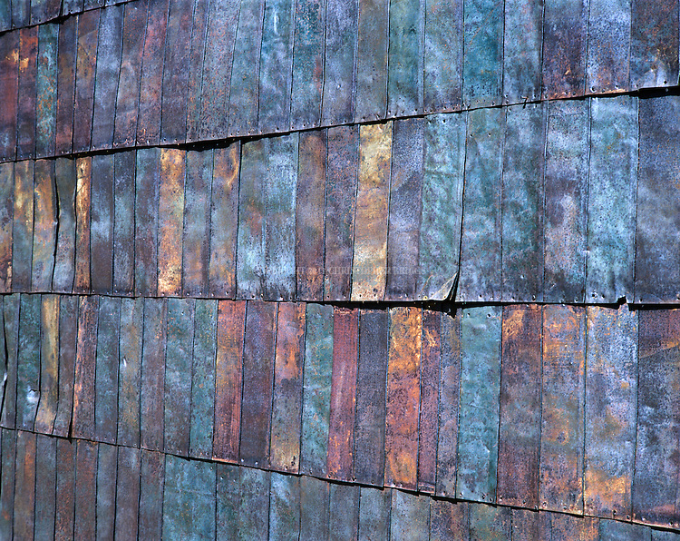 An exterior wall on one of fewer than 170 structures remaining in the ghost town of Bodie (fewer that 5% of the original buildings); gold discovered here in 1859. Metal for roofing and siding was obtained from kerosene and gasoline cans that were cut open and flattened for use in construction. Designated National Historic Landmark in 1961; 1962 it became Bodie State Historic Park. Bodie named California's official state gold rush ghost town. Historic District, California State Park. Mono County, CA.