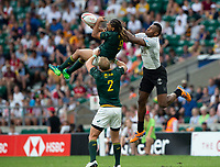 Twickenham, United Kingdom. 3rd June 2018, HSBC London Sevens Series. Game 45. Cup Final.  Fiji vs South Africa. <br /> <br /> Fiji's, Sevuloni MOCENACAGI, challenges, Justin GEDULD, lifted by, Phillip SNYMAN, during the Rugby 7's, match played at the  RFU Stadium, Twickenham, England, <br /> <br /> <br /> <br /> &copy; Peter SPURRIER/Alamy Live News