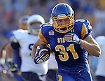 BROOKINGS, SD - AUGUST 31:  Zach Zenner #31 from South Dakota State University breaks loose for a 36 yard touchdown on the opening drive against Butler in the first quarter Saturday evening at Coughlin Alumni Stadium in Brookings. (Photo by Dave Eggen/Inertia)