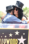 LOS ANGELES - JUL 10: Slash, Charlie Sheen at a ceremony where Slash is honored with the 2,473rd Star on the Hollywood Walk of Fame on July 10, 2012 in Los Angeles, California