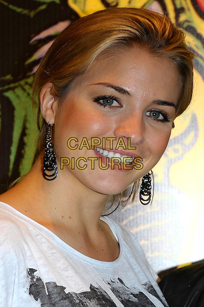 "GEMMA ATKINSON .attending ""13 Hours"" World Film Premiere during day 3 of Frightfest film festival held at the Empire cinema Leicester Square, London, England, UK, .28th August 2010..portrait headshot  black white print top smiling earrings dangly .CAP/CJ.©Chris Joseph/Capital Pictures."