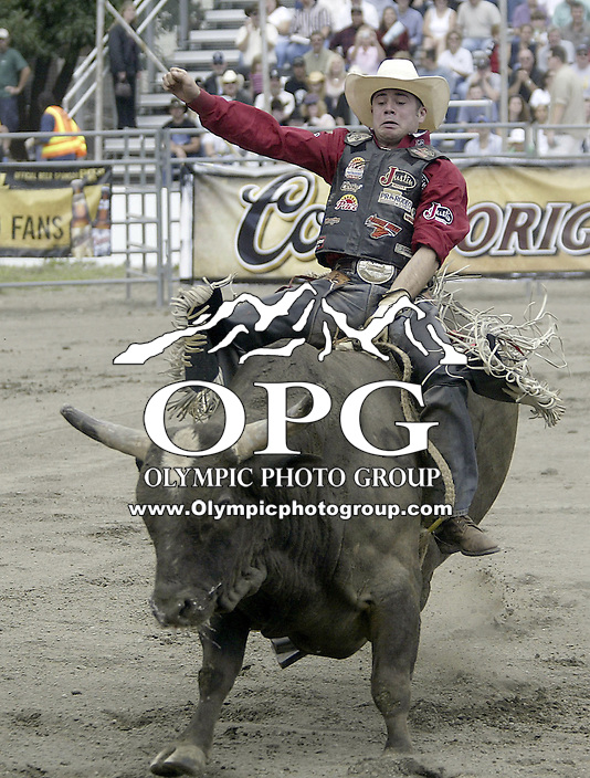 29 August, 2004:  PRCA Rodeo Bull Rider Bryan Richardson ranked 21st in the world riding the bull Can't Wait during the PRCA 2004 Extreme Bulls competition in Bremerton, WA.