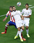 Atletico de Madrid's Mario Mandzukic (l) and Real Madrid's Daniel Carvajal (c) and Raphael Varane during Supercup of Spain 2nd match.August 19,2014. (ALTERPHOTOS/Acero)