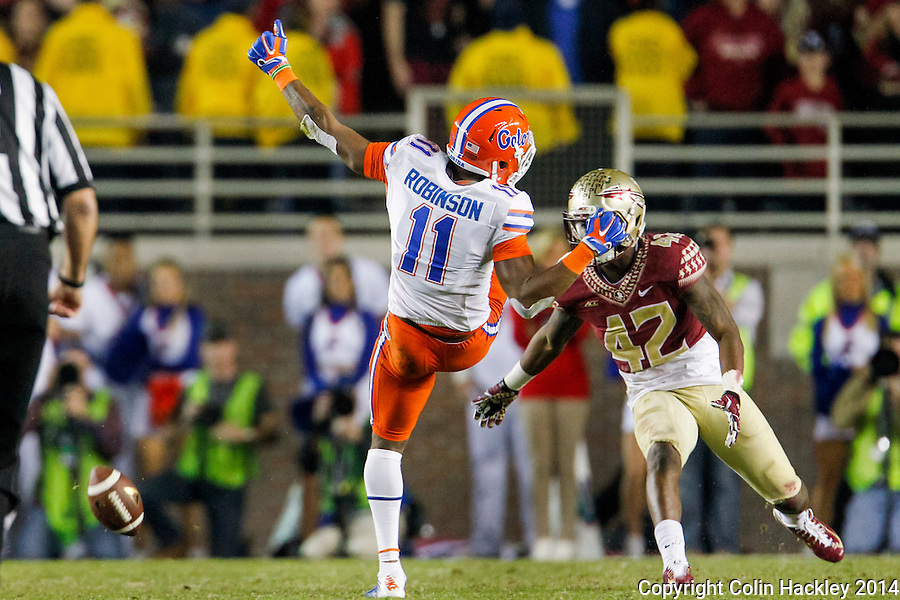 TALLAHASSEE, FL 11/29/14 FSU-UF112914-University of Florida's Demarcus Robinson can't catch the final Gator pass of the game against Florida State's Lamarcus Brutus during second half action Saturday at Doak Campbell Stadium in Tallahassee. The Seminoles beat the Gators 24-19.<br /> COLIN HACKLEY PHOTO