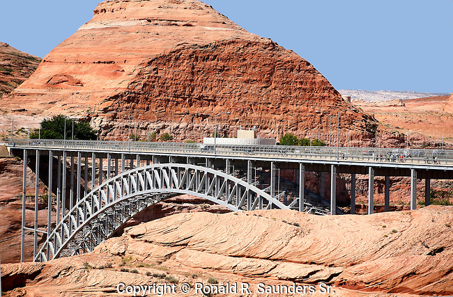 THE GLEN CANYON BRIDGE or GLEN CANYON DAM BRIDGE is a STEEL ARCH BRIDGE in COCONINO COUNTRY, ARIZONA, CARRYING U.S. ROUTE 89 ACROSS the COLORADO RIVER. The BRIDGE WAS ORIGINALLY BUILT BY the U.S. BUREAU of RECLAMATION  to FACILITATE TRANSPORTATION of  MATERIALS for the GLEN CANYON DAM,WHICH LIES ADJACENT to the BRIDGE JUST 865 FEET (264 m) UPSTREAM. CARRYING TWO LANES, the BRIDGE RISES OVER 700 FEET (210 m) ABOVE the RIVER and was the HIGHEST ARCH BRIDGE in the WORLD at the TIMES of its COMPLETION in 1959.