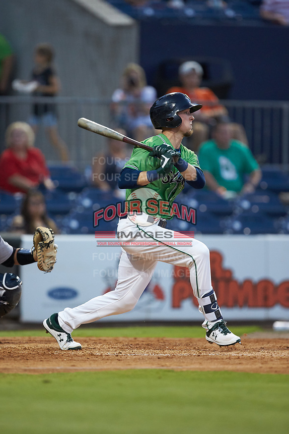 Drew Waters (11) of the Gwinnett Stripers follows through on his swing against the Scranton/Wilkes-Barre RailRiders at BB&T BallPark on August 16, 2019 in Lawrenceville, Georgia. The Stripers defeated the RailRiders 5-2. (Brian Westerholt/Four Seam Images)
