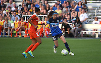Kansas City, MO - Saturday May 07, 2016: FC Kansas City midfielder Erika Tymrak (15) moves the ball against Houston Dash defender Poliana Barbosa (2) during a regular season National Women's Soccer League (NWSL) match at Swope Soccer Village.