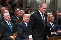 Former President George W. Bush walks past President Donald Trump and former President Barack Obama to speak a State Funeral for President George H.W. Bush, at the National Cathedral, Wednesday, Dec. 5, 2018, in Washington. <br /> CAP/MPI/RS<br /> &copy;RS/MPI/Capital Pictures
