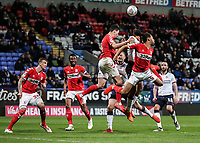 Bolton Wanderers' Josh Magennis competing with Middlesbrough's Ryan Shotton at a free kick<br /> <br /> Photographer Andrew Kearns/CameraSport<br /> <br /> The EFL Sky Bet Championship - Bolton Wanderers v Middlesbrough -Tuesday 9th April 2019 - University of Bolton Stadium - Bolton<br /> <br /> World Copyright © 2019 CameraSport. All rights reserved. 43 Linden Ave. Countesthorpe. Leicester. England. LE8 5PG - Tel: +44 (0) 116 277 4147 - admin@camerasport.com - www.camerasport.com