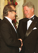 Jack Nicholson, left, is welcomed by United States President Bill Clinton, right, to the White House Millennium Dinner in Washington, D.C. on December 31, 1999..Credit: Ron Sachs / CNP