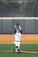 Georgetown Hoyas center fielder Evan Ryan (9) catches a fly ball against the Delaware Blue Hens at Wake Forest Baseball Park on February 13, 2015 in Winston-Salem, North Carolina.  The Blue Hens defeated the Hoyas 3-0.  (Brian Westerholt/Four Seam Images)