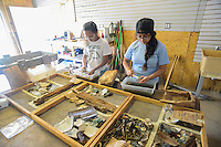 HAZLETON, PA - JUNE 30: From left, Milka Cerda and Lizbeth Fuentes view and clean artifacts uncovered at the site of an archaeologic dig June 30, 2014 in Hazleton, Pennsylvania. The team is looking through sites connected with the Lattimer Massacre which occurred in 1897. (Photo by William Thomas Cain/Cain Images)