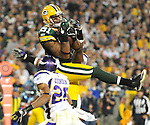 Green Bay Packers Andrew Quarless catches a pass for a touchdown against the Minnesota Vikings during the 2nd quarter of the game at Lambeau Field in Green Bay, Wis., on Oct. 24, 2010.