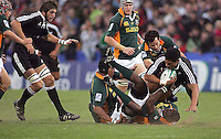 New Zealand centre Robert Fruean is tackled by South African flanker Thiliphaut Marole during the U19 Championship final against South Africa at Ravenhill, Belfast.