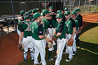 Dartmouth Big Green team huddle before a game against the Northeastern Huskies on March 3, 2018 at North Charlotte Regional Park in Port Charlotte, Florida.  Northeastern defeated Dartmouth 10-8.  (Mike Janes/Four Seam Images)