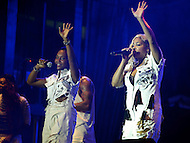 "Largo, MD - July 12, 2014: Rozonda ""Chilli"" Thomas and Tionne ""T-Boz"" Watkins (r), of the Grammy award winning group TLC, performs at the 1st annual International Festival at the Largo Town Center in Largo, MD, July 12, 2014. The group is known for its hit songs ""Creep"" and ""Scrubs."" (Photo by Don Baxter/Media Images International)"