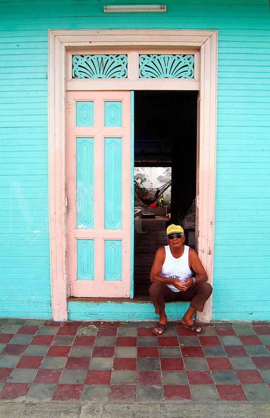 Man sitting in doorway San Juan del Sur, Nicaragua.
