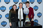 Wake Forest Demon Deacons head football coach Dave Clawson (center) poses for a photo with his daughter Courtney (left) and his son Eric (right) at the Belk Bowl Media Day at the Charlotte Convention Center on December 28, 2017 in Charlotte, North Carolina.  (Brian Westerholt/Sports On Film)