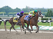 Devil May Care edges Connie And Michael in the Mother Goose Stakes at Belmont Park on June 26.