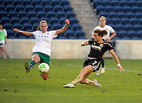 Red Stars defender Whitney Engen (9) flies through the air in an effort to block a shot by FC Gold Pride forward Kelly O'Hara (7).  The FC Gold Pride defeated the Chicago Red Stars 3-2 at Toyota Park in Bridgeview, IL on August 22, 2010