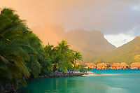 Sunrise and bungalows with lagoon. Bora Bora. French Polynesia.