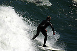 """Surfing is a surface water sport in which the wave rider, referred to as a """"surfer"""", rides on the forward face of a wave, which is most often carrying the surfer towards shore<br /> (4)"""