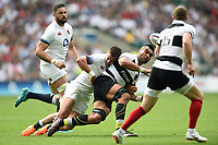 Victor Vito of the Barbarians offloads the ball after being tackled by Henry Trinder of England. Quilter Cup International match between England and the Barbarians on May 27, 2018 at Twickenham Stadium in London, England. Photo by: Patrick Khachfe / Onside Images