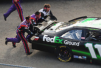 Sept. 21, 2008; Dover, DE, USA; Nascar Sprint Cup Series driver Denny Hamlin is pushed into the garage after an engine problem during the Camping World RV 400 at Dover International Speedway. Mandatory Credit: Mark J. Rebilas-