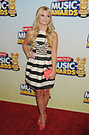 LOS ANGELES, CA- APRIL 27: Actress Olivia Holt arrives at the 2013 Radio Disney Music Awards at Nokia Theatre L.A. Live on April 27, 2013 in Los Angeles, California.