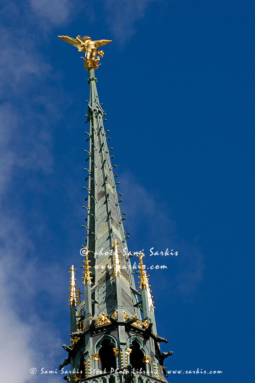 Spire of the abbey with a statue of Archangel Michael on the top, Mont Saint-Michel, Normandy, France.